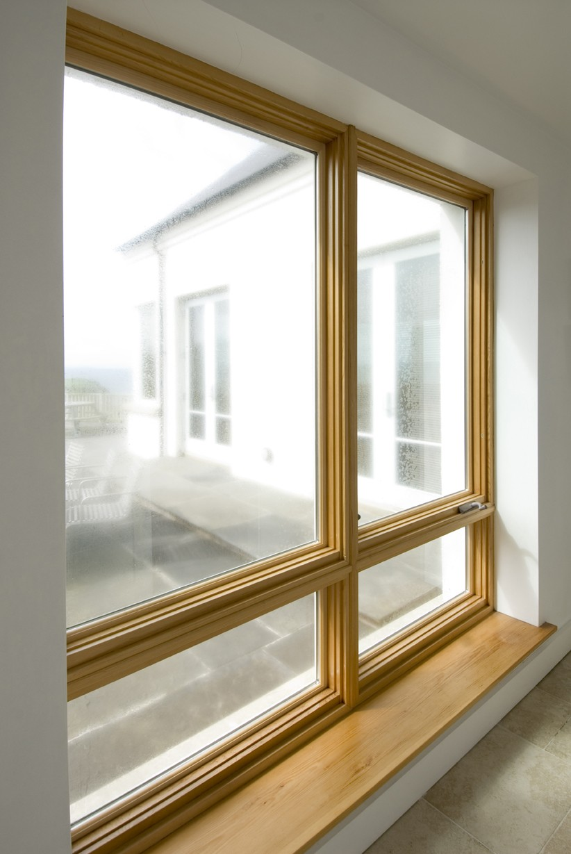 Casement style window with fixed units
