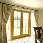 French door with wooden frame matching the traditional window style