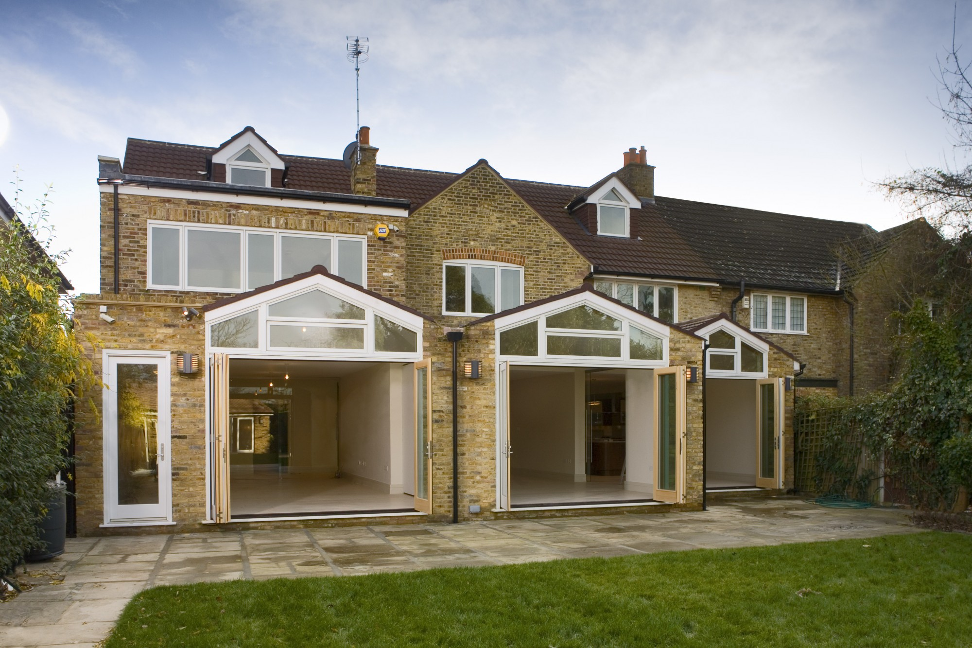 Megrame white Bi-Fold doors for gardens.