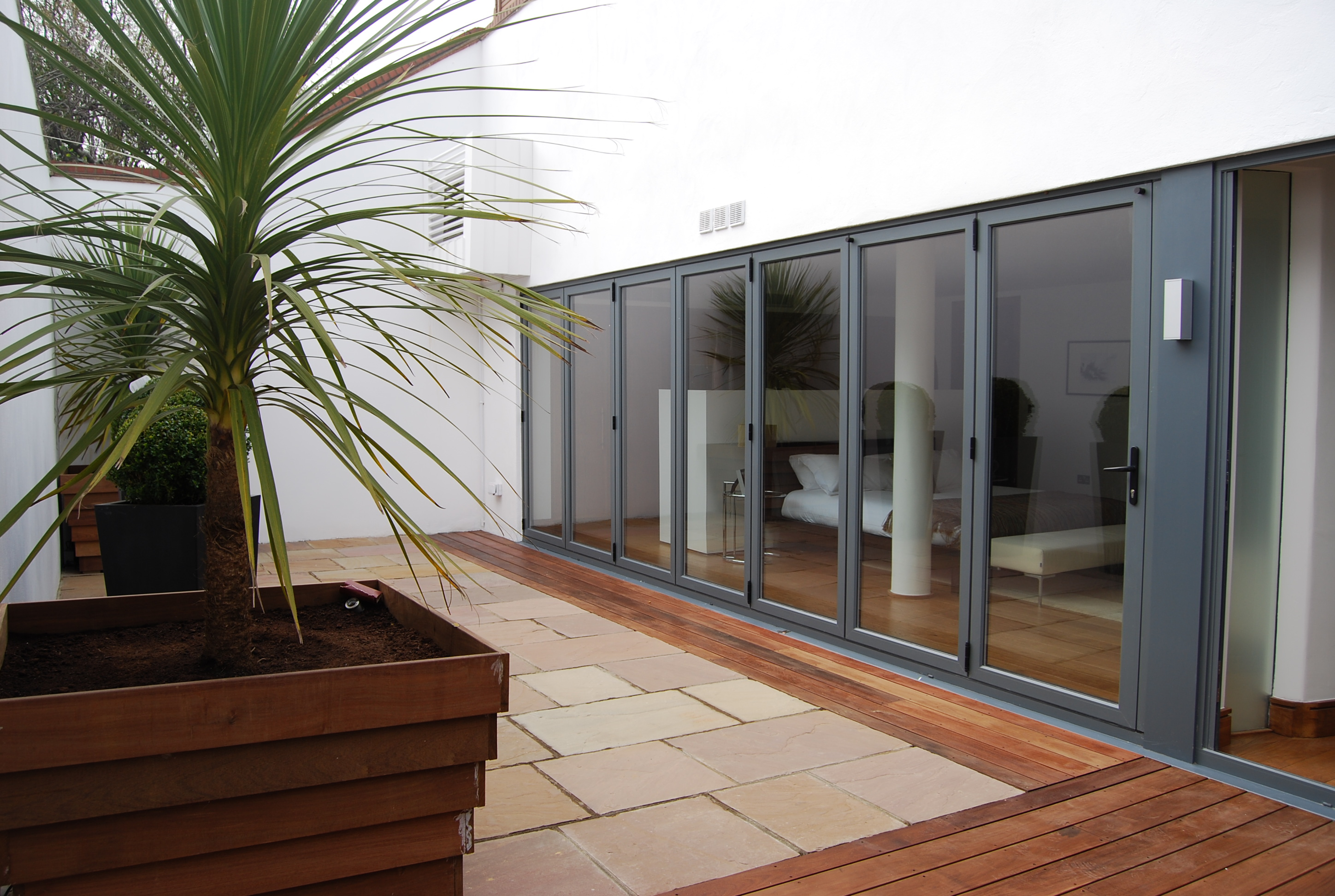 Signature bi-fold door with grey panel for conservatory