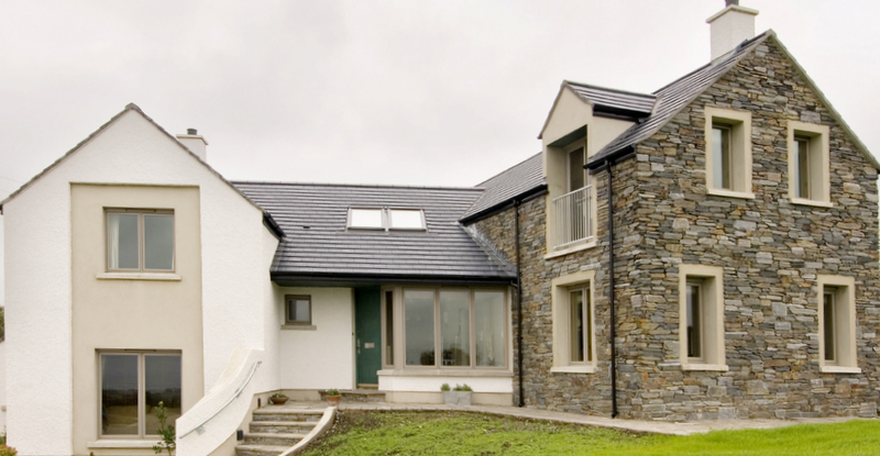 Clad windows and french doors in new home