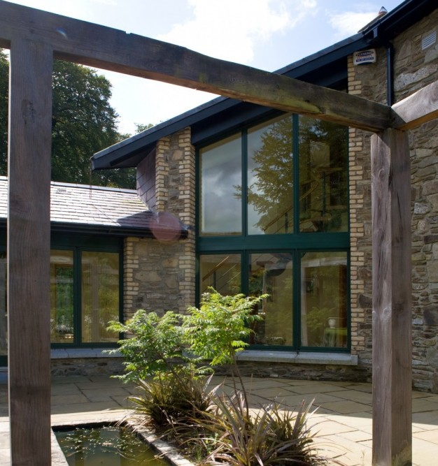 Backyard lodge extension with casement windows