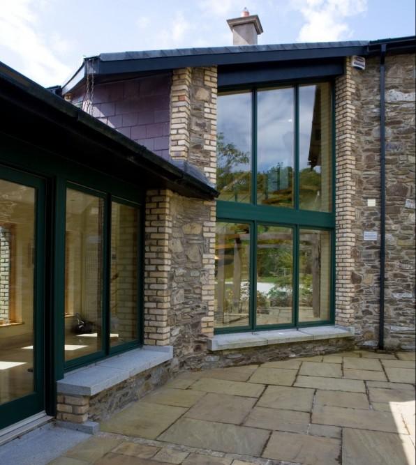 Green Casement windows and large glass screen