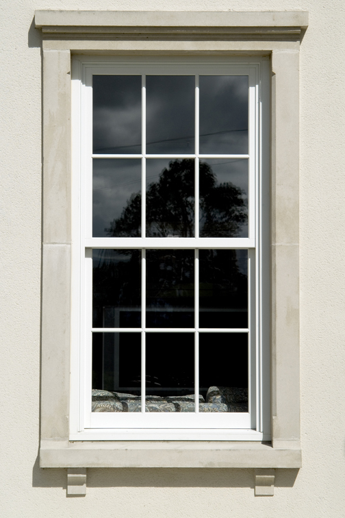 Sliding sash window with glazing bars