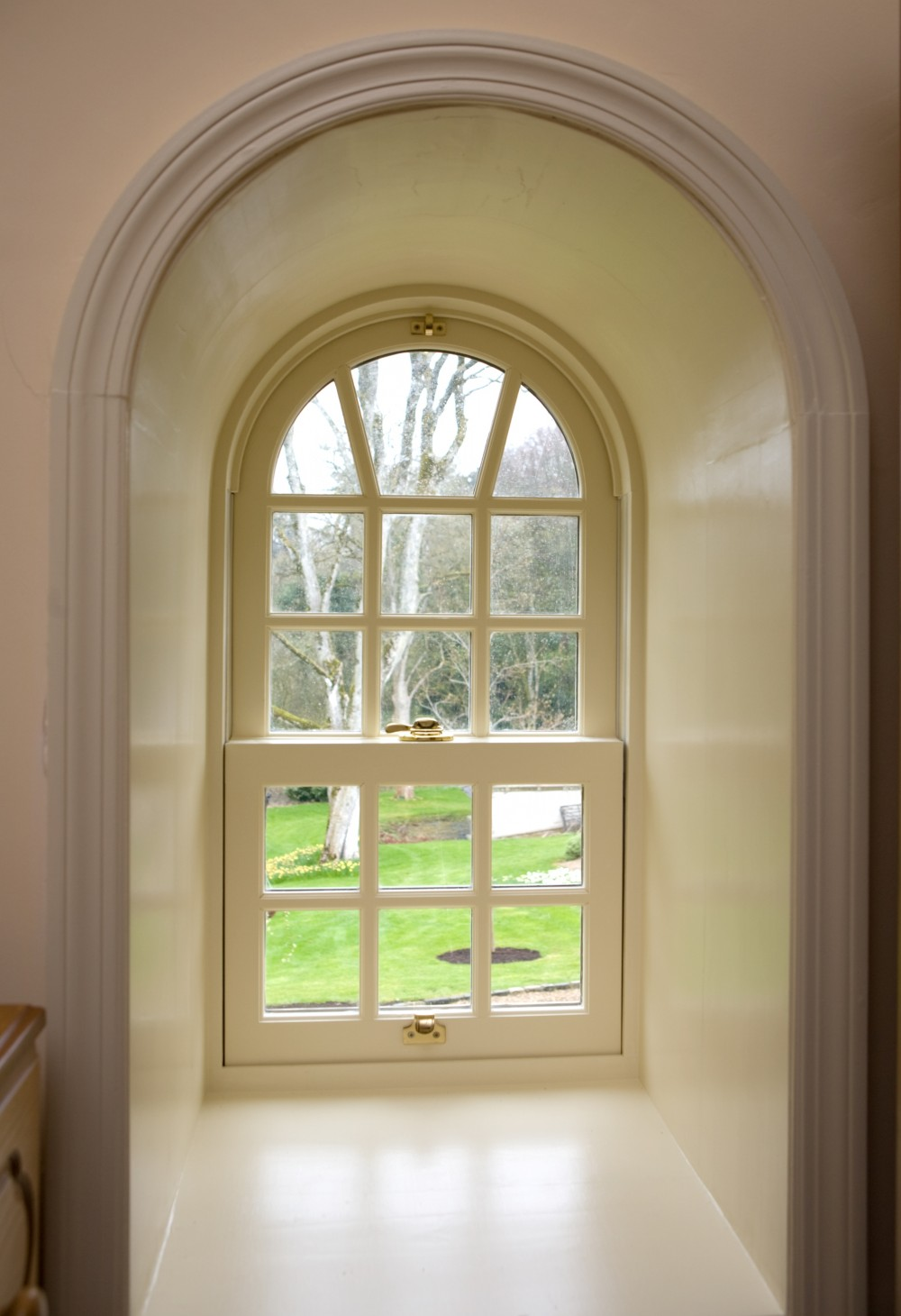 Sliding sash for arch type window designs