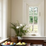 Megrame casement window with white wood panel