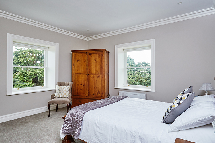 Bedroom featuring Signature's aluminium clad wood sliding sash windows